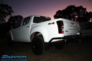 """Rear right view of a White Isuzu D-Max Dual Cab after being fitted with a Superior Remote Reservoir 2"""" Inch Lift Kit, Airbag Man Leaf Air Kit, Ironman 4x4 Bullbar + Side Steps, VRS Winch, Safari Snorkel + King Wheels & Nitto Tyres"""