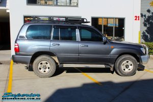 "Right side view of a Silver Toyota 100 Series Landcruiser before fitment of a 2"" Inch Lift Kit with Airbags"
