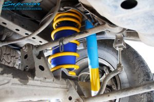 Rear left underbody inside view of the fitted Bilstein Shock, King Coil Spring + Airbag