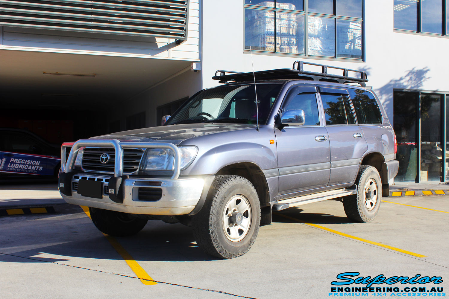 "Left front side view of a Silver Toyota 100 Series Landcruiser after fitment of a 2"" Inch Lift Kit with Airbags"
