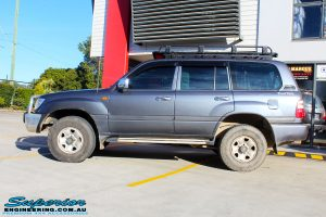 """Left side view of a Silver Toyota 100 Series Landcruiser after fitment of a 2"""" Inch Lift Kit with Airbags"""