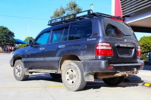 "Rear left view of a Silver Toyota 100 Series Landcruiser after fitment of a 2"" Inch Lift Kit with Airbags"