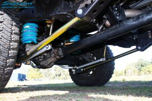Mid rear left outside view of the fitted Superior Lower Control Arm, Sway Bar Kit & Airbag Man Coil Air Helper Kit with Coil Spring