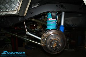 Rear left shot of the fitted Airbag Man Coil Air Helper Kit, Remote Reservoir Shock & Swaybar Kit