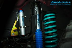 """Front left inside guard view of the fitted 2"""" Superior Remote Reservoir Shock, Mount + Dobinson Coil Spring"""