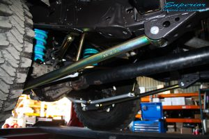 Mid rear right view of the fitted Superior Lower Control Arm, Sway Bar Kit & Airbag Man Coil Air Helper Kit with Coil Spring