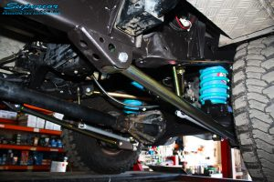 Mid rear left view of the fitted Superior Lower Control Arm, Sway Bar Kit & Airbag Man Coil Air Helper Kit with Coil Spring