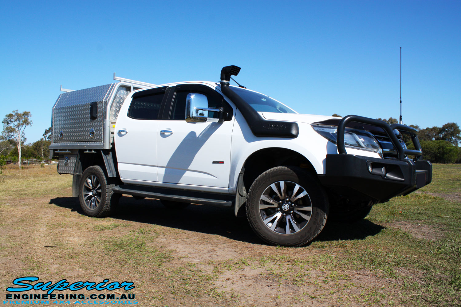 "Right front side view of a White Holden RG Colorado Dual Cab after fitment of a Superior Remote Reservoir 2"" Inch Lift Kit, Superior Chassis Brace/Repair Plate, Airbag Man Leaf Air Kit & Clearview Towing Mirrors"