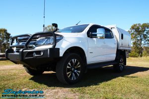 """Left front side view of a White Holden RG Colorado Dual Cab after fitment of a Superior Remote Reservoir 2"""" Inch Lift Kit, Superior Chassis Brace/Repair Plate, Airbag Man Leaf Air Kit & Clearview Towing Mirrors"""