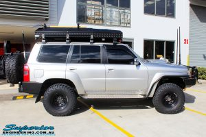 Right side view of a Nissan GU Patrol Wagon before fitment of a Airbag Man Coil Air Kit & Superior Drop Out Cones