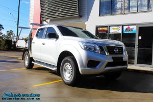 "Right front side view of a Silver Nissan NP300 Navara Dual Cab before fitment of a Superior Remote Reservoir 2 Inch Lift Kit & Airbag Man Coil Air Kit 2"" Inch Lift"