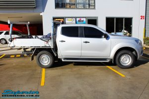 """Right side view of a Silver Nissan NP300 Navara Dual Cab before fitment of a Superior Remote Reservoir 2 Inch Lift Kit & Airbag Man Coil Air Kit 2"""" Inch Lift"""