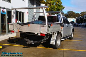 """Rear right view of a Silver Nissan NP300 Navara Dual Cab before fitment of a Superior Remote Reservoir 2 Inch Lift Kit & Airbag Man Coil Air Kit 2"""" Inch Lift"""