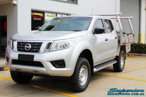 """Left front side view of a Silver Nissan NP300 Navara Dual Cab after fitment of a Superior Remote Reservoir 2 Inch Lift Kit & Airbag Man Coil Air Kit 2"""" Inch Lift"""
