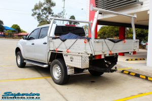 """Rear left view of a Silver Nissan NP300 Navara Dual Cab after fitment of a Superior Remote Reservoir 2 Inch Lift Kit & Airbag Man Coil Air Kit 2"""" Inch Lift"""