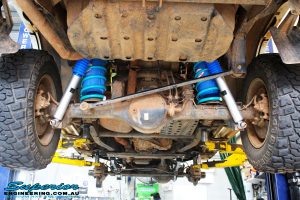 """Rear mid underbody shot of the fitted Superior Nitro Gas 2"""" Shocks + Coil Springs & Airbag Man Coil Air Kit"""