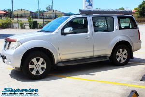 Left front side view of a Nissan R51 Pathfinder in Silver before fitment of a Airbag Man Standard Height Coil Air Kit