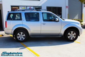 Right side view of a Nissan R51 Pathfinder in Silver after fitment of a Airbag Man Standard Height Coil Air Kit