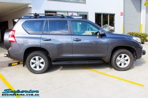 """Right side view of a Grey Toyota 150 Landcruiser Prado Wagon before fitment of a Superior Remote Reservoir 2"""" Inch Lift Kit, Airbag Man Coil Air Kit & King Springs"""
