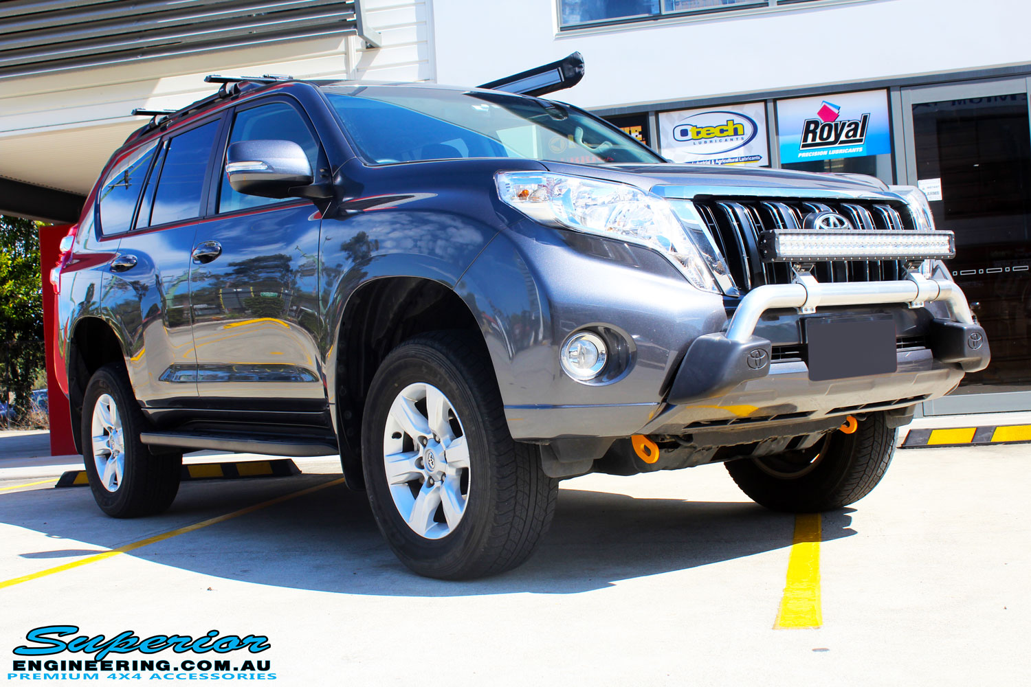 "Right front side view of a Grey Toyota 150 Landcruiser Prado Wagon after fitment of a Superior Remote Reservoir 2"" Inch Lift Kit, Airbag Man Coil Air Kit & King Springs"