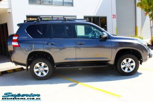 """Right side view of a Grey Toyota 150 Landcruiser Prado Wagon after fitment of a Superior Remote Reservoir 2"""" Inch Lift Kit, Airbag Man Coil Air Kit & King Springs"""