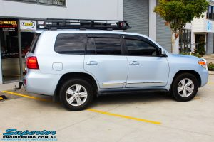"""Right side view of a Blue Toyota 200 Series Landcruiser before fitment of a Superior Remote Reservoir 2"""" Inch Lift Kit & Airbag Man Coil Air Helper Kit"""