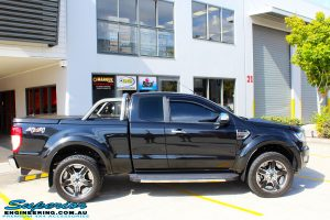 "Right side view of a Ford PXII Ranger in Black before fitment of a Superior 2"" Inch Remote Reservoir Lift Kit + Airbag Man Leaf Air Kit"