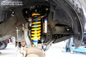Front right inside guard view of the fitted Remote Reservoir Front Strut with Mount + Coil Springs