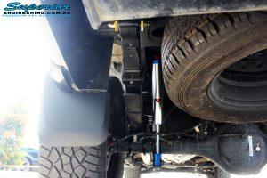Rear left underbody shot of the fitted Piggy Back Remote Reservoir Shock, U-Bolt Kit and Rear Leaf Spring