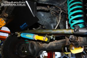 Left close up shot of the front underbody fitted Superior Drag Link & Adjustable Panhard Rod