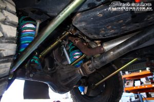 Right mid underbody rear shot looking at the fitted Superior Upper & Lower Control Arms with Coil Springs and Airbag Coil Air Kit