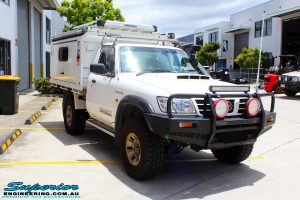 Right front side view of a White Nissan GU Patrol after fitment of a range of Superior and various other brands suspension components