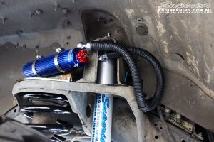 """Close up shot inside the right guard of the fitted Superior 3"""" Remote Reservoir Front Shock with Coil Spring"""