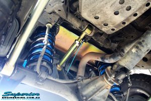 Rear underbody shot of the fitted Superior Lower & Upper Control Arms with Coil Spring and Airbag Man Coil Helper Air Kit