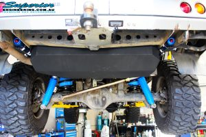 Mid rear underbody shot of the fitted Superior Remote Reservoir Shocks, Coil Springs, Airbag Man Coil Air Helper Kit and Superior Panhard Rod