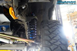 "Front left shot of the passenger front suspension setup of the Superior 3"" Remote Reservoir Front Shock with Coil Spring"