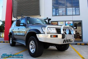 """Front right side view of the Nissan GU Patrol Wagon before fitment of a Superior Remote Reservoir 2"""" Inch Lift Kit"""