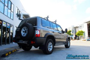 """Rear right side view of a Nissan GU Patrol Wagon before fitment of a Superior Remote Reservoir 2"""" Inch Lift Kit"""