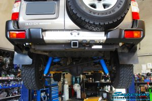 """Rear underbody mid shot of the fitted Superior 2"""" Remote Reservoir Rear Shocks with Coil Springs and Airbag Man Coil Air Helper Kit"""