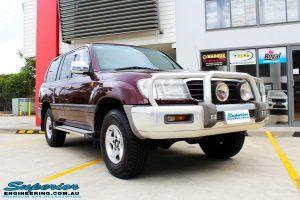 """Right front side view of a Maroon Toyota 105 Series Landcruiser Dual Cab before fitment of a Superior Nitro Gas 3"""" Inch Lift Kit with Airbag Man 3"""" Coil Air Kit"""