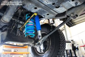 """Left rear underbody shot looking at the fitted Superior 3"""" Inch Nitro Gas Shock with Coil Spring, Airbag Man Coil Air Kit and Superior Upper Control Arm"""