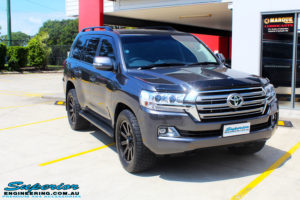 """Right front side view of a Grey Toyota 200 Series Landcruiser before fitment of a Superior Remote Reservoir 2"""" Inch Lift Kit with King Springs & Airbag Man 2"""" Coil Air Helper Kit"""