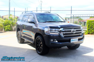 """Right front side view of a Grey Toyota 200 Series Landcruiser after fitment of a Superior Remote Reservoir 2"""" Inch Lift Kit with King Springs & Airbag Man 2"""" Coil Air Helper Kit"""