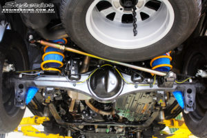 Rear mid underbody shot of the fitted Superior Adjustable Panhard Rod, Remote Reservoir Shocks, King Coil Springs and Airbag Man Coil Air Helper Kit