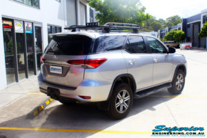 "Rear right side view of a Toyota Fortuner Wagon in Silver before fitment of a Fox 2.0 Performance Series IFP 2"" Inch Lift Kit with Airbag Man Coil Helper Air Kit"