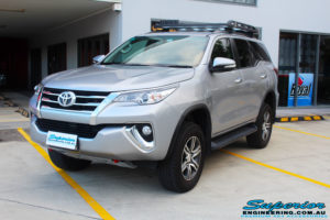 """Left front side view of a Toyota Fortuner Wagon in Silver after fitment of a Fox 2.0 Performance Series IFP 2"""" Inch Lift Kit with Airbag Man Coil Helper Air Kit"""