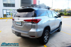 """Rear right side view of a Toyota Fortuner Wagon in Silver before fitment of a Fox 2.0 Performance Series IFP 2"""" Inch Lift Kit with Airbag Man Coil Helper Air Kit"""